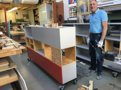 Ron Boudrie with one of the cabinets
